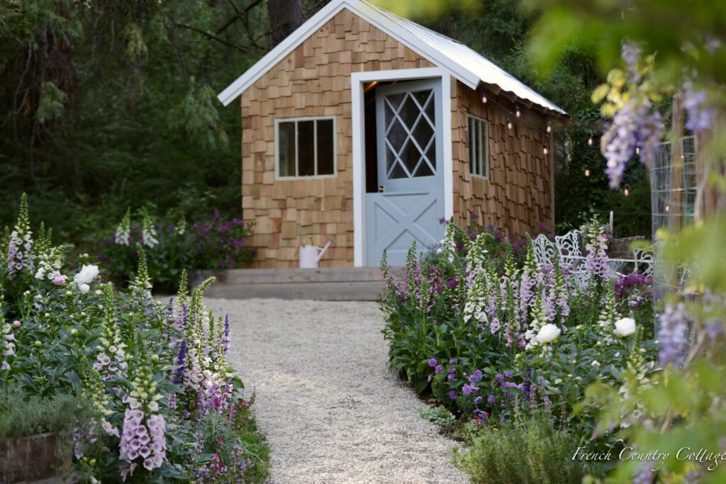 Shingled garden shed in garden