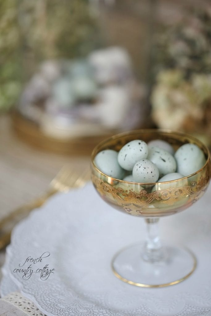 Easter eggs in gold glass on plate