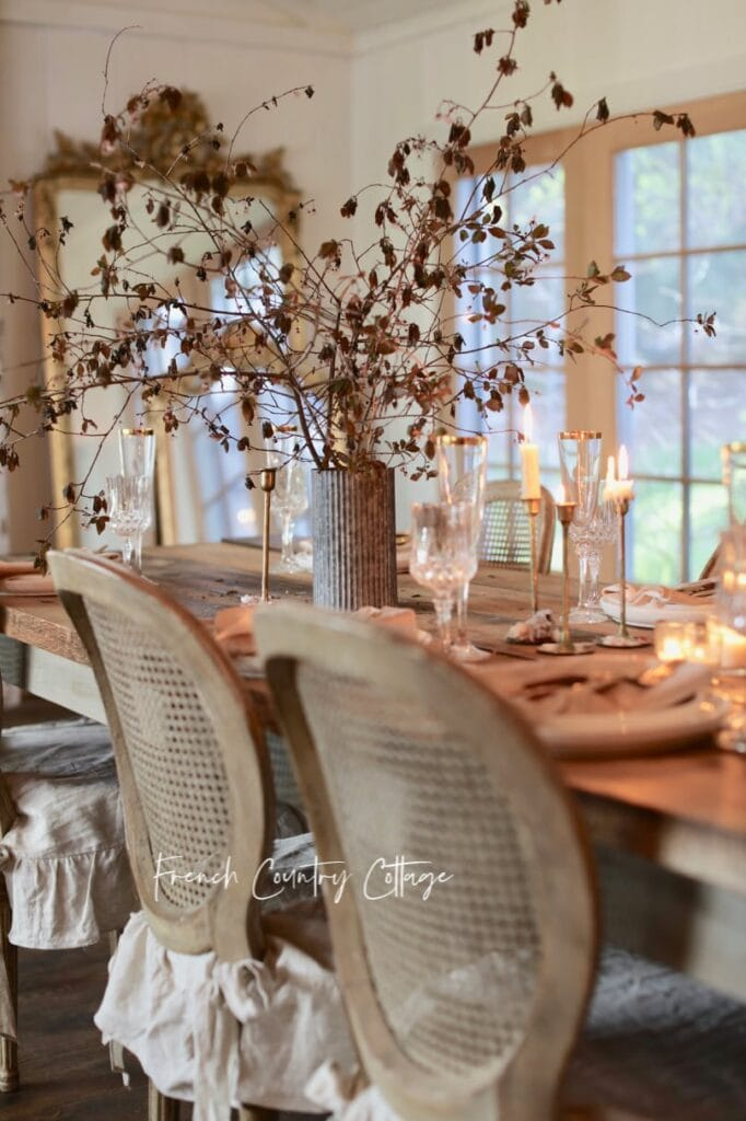 Plum tree branches as a centerpiece on Easter table