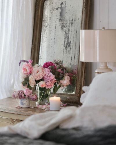 Flowers on nightstand in bedroom