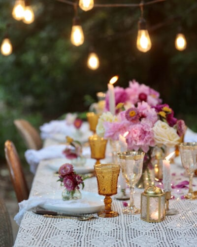 Peonies and twinkle lights summer table