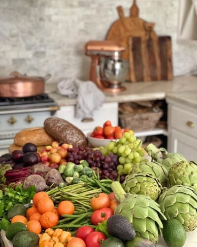 Fresh fruit and vegetables on kitchen island