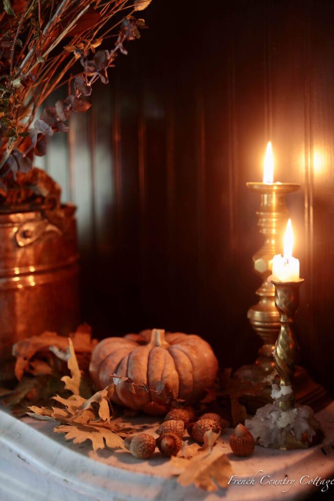 close up of candle, acorns and pumpkins