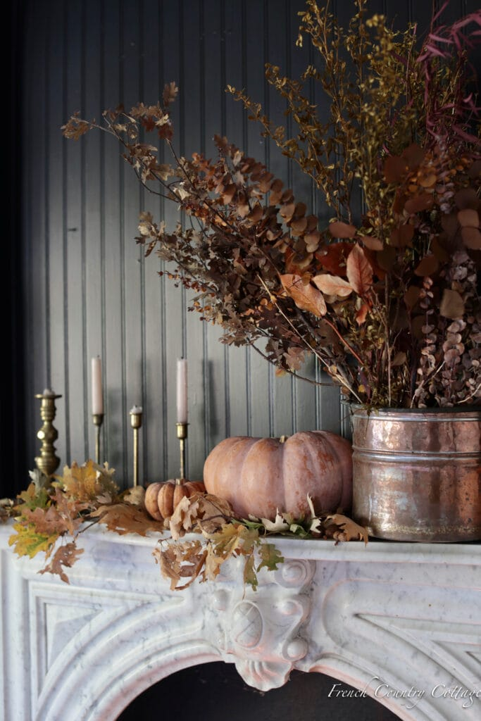 Autumn mantel styling with branches and pumpkins