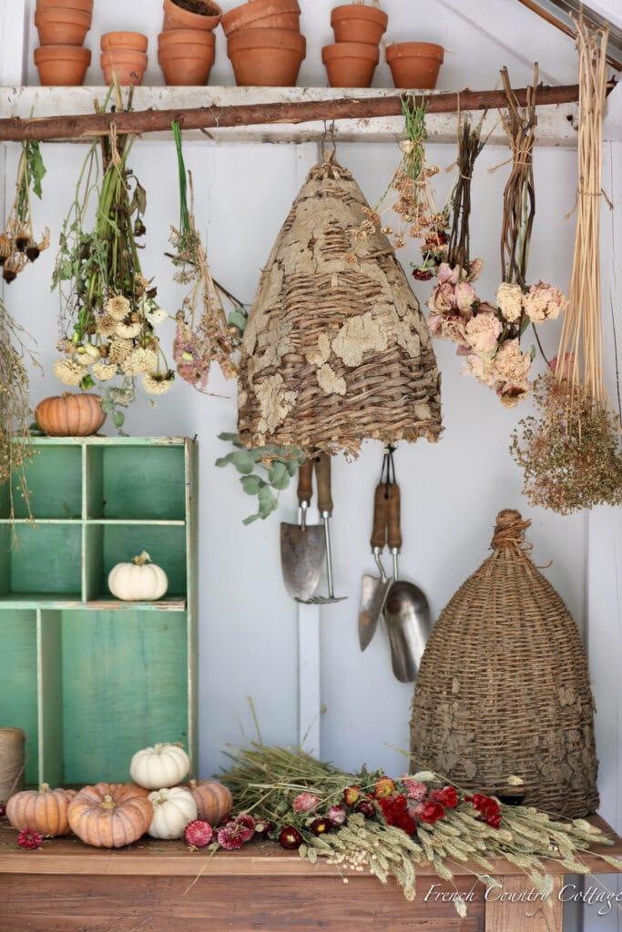 vintage bee skeps and garden bits in potting shed