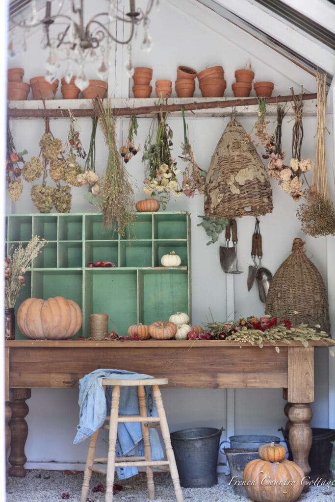 vintage potting shed table with garden bits and dried flowers