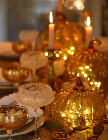 glowing pumpkins on table