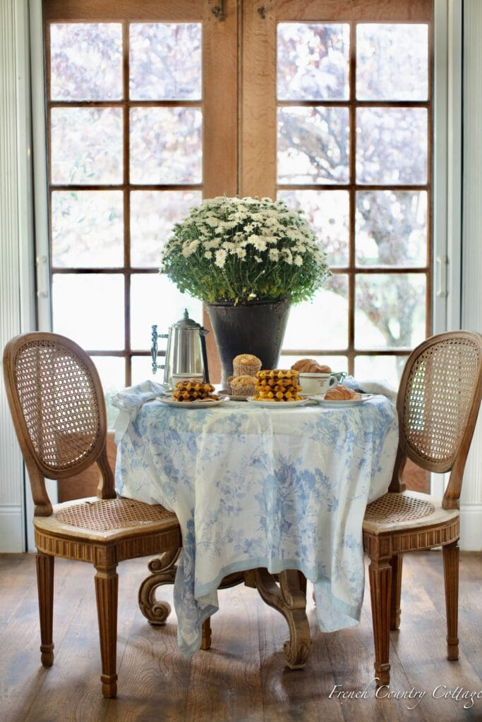breakfast table with blue and white tablecloth and waffles